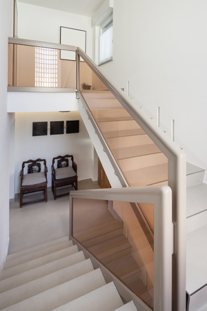 indoor inside: Entry of an apartment, staircase and white walls