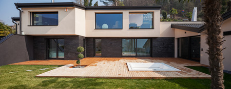 outside house: Exterior of a modern villa, veranda with pool