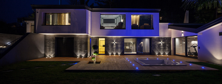 home exterior: Exteriors of modern luxury villa in the night