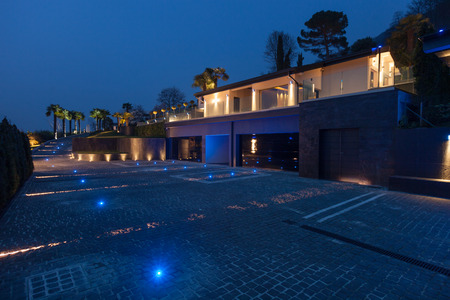 outdoor lighting: Exterior view of a modern luxury villa, nobody inside Stock Photo
