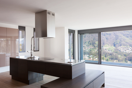 Interior of modern apartment, island kitchen. Nobody inside