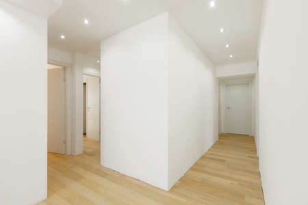 Empty corridor in white flat. Nobody inside