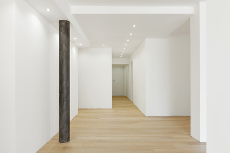 White empty corridor, brown pillar. Nobody inside