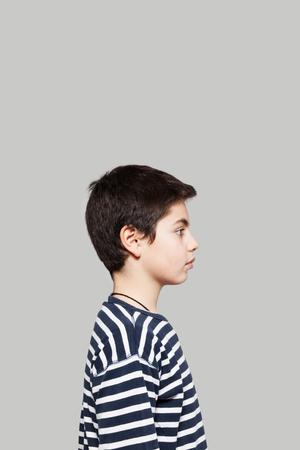 Sweet boy wearing striped shirt, profile view Stock Photo