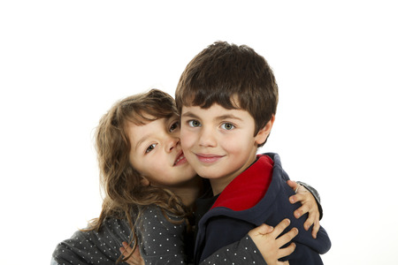 embraced: Portrait of children embraced, isolated on white background Stock Photo