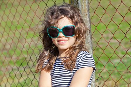 portrait of nice little girl with glasses fashion Archivio Fotografico
