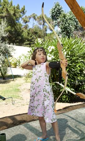 portrait of a girl, archery, outdoor Archivio Fotografico