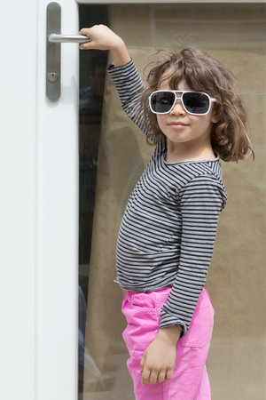 portrait of little girl with sunglasses, external
