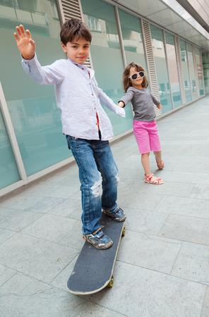 portrait of two children on the sidewalk Archivio Fotografico