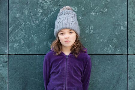 portrait of a casual little girl with wool hat, outdoors Archivio Fotografico