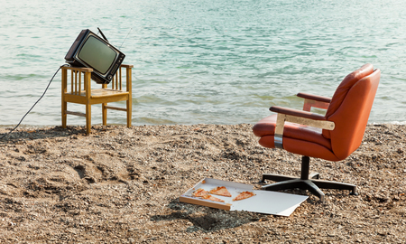 outmoded: vintage decor on the lake shore, armchair and television Stock Photo