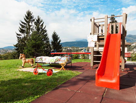 garden with childrens playground, outdoors Stock Photo