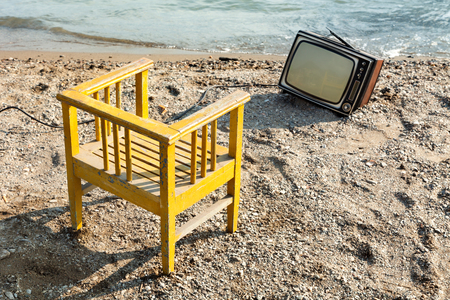 vintage decor on the lake shore, chair and television