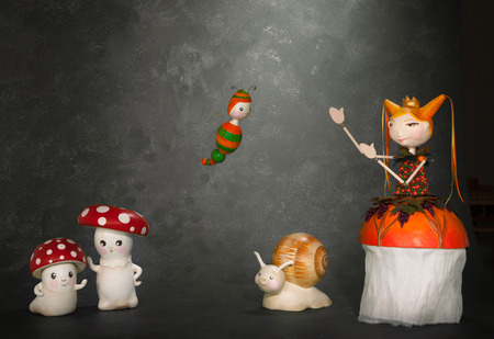 puppets: ceramic puppets handmade, gray background Stock Photo