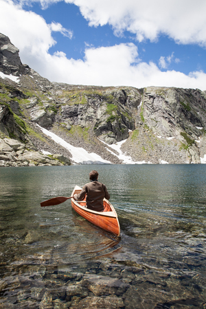 Wooden canoe during sailing in the Swiss lake