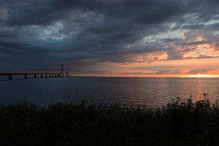 Storebæltsbroen bridge. The sun is setting Lizenzfreie Bilder