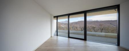 Big windows of a modern empty room