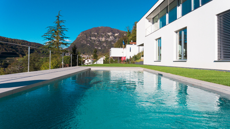 Modern luxury villa with garden and swimming pool