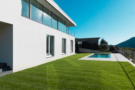 Modern white villa with garden