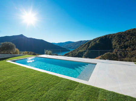 Swimming pool with lake and valley view Stock Photo