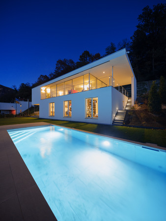 Modern house, exterior in the night, lights on Stock Photo