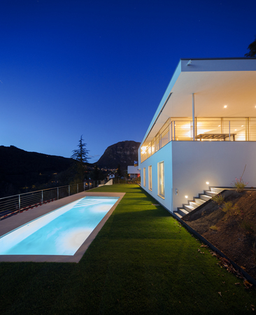 Modern house, exterior in the night, lights on Archivio Fotografico