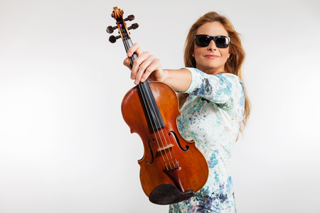 Young blond woman posing in studio with white background. He is a violinist Stock Photo