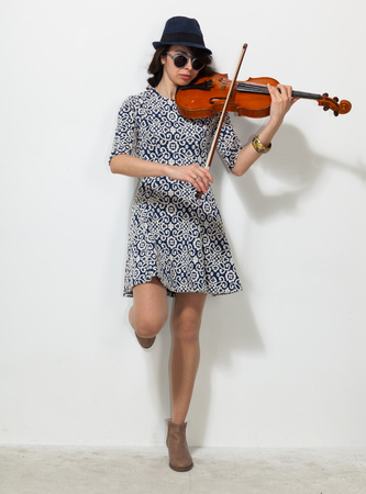 Young woman with dark glasses and a violin in her hand