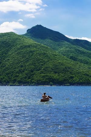 boy with canoe on lake naked chest