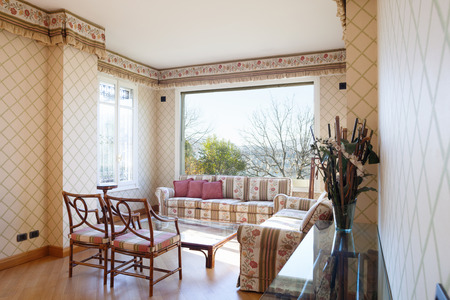 Vintage living room with upholstered and lake view, great for a bit of relaxation