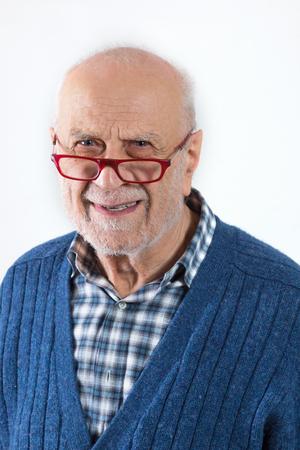 Elderly man portrait with plaid shirt. Isolated on white background