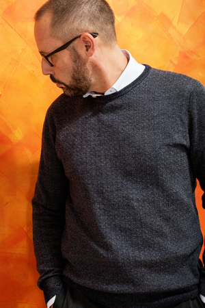 Portrait of elegant dressed businessman with sweater, shirt and eyeglasses