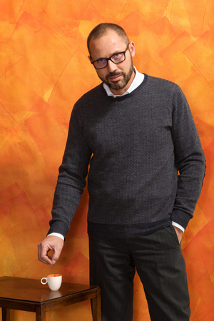 Portrait of elegant dressed businessman with sweater, shirt and eyeglasses