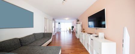Spacious living room with large sofa. Very intimate and welcoming apartment Stok Fotoğraf