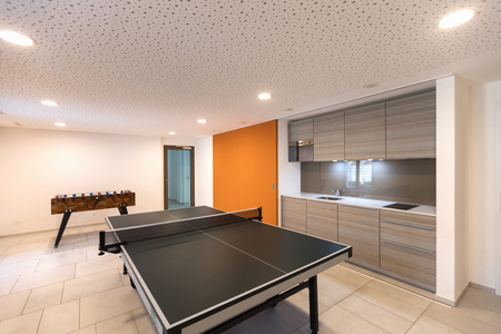 Games room with table tennis and table football. Nobody inside. Standard-Bild - 103170192
