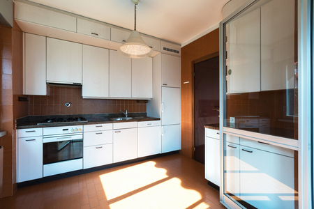 House kitchen to be renovated white with strong contrasts. Nobody inside. Foto de archivo