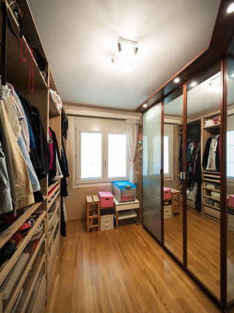walk-in closet with clothes Stock Photo