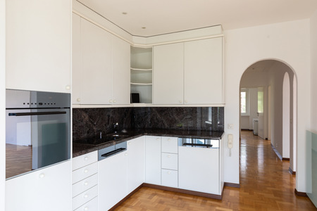 Modern white kitchen in a renovated villa. Nobody inside, perfect for copy-space