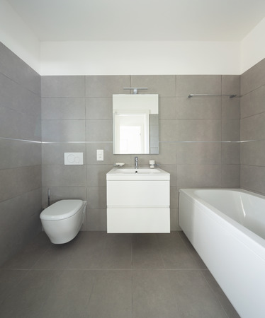 Modern bathroom with large tiles in newly built apartment. Nobody inside Standard-Bild - 103043707