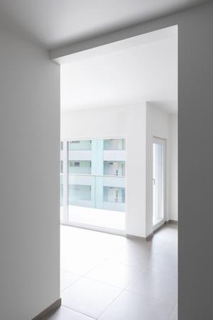 Detail of open doors in all-white apartment. nobody inside. Concept Standard-Bild - 103016392