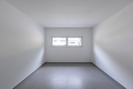 Empty room and white walls with window with a view. Nobody inside