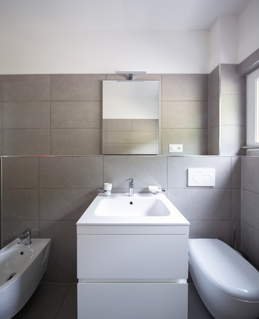Modern bathroom with large tiles in newly built apartment. Nobody inside Standard-Bild - 103044761