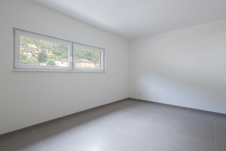 Empty room and white walls with window with a view. Nobody inside Standard-Bild - 103050420