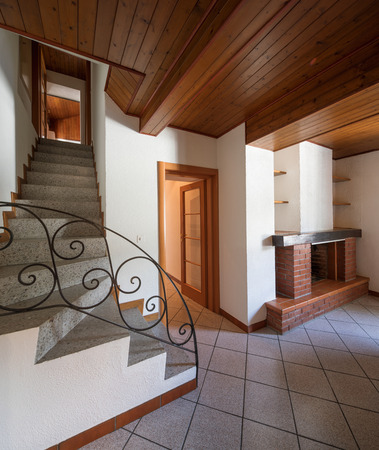 Open door with granite stairs, another door and a fireplace. Nobody inside Standard-Bild - 103177984