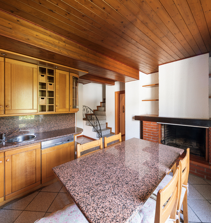 Kitchen with table and wooden furniture. Nobody inside. Standard-Bild - 103119610