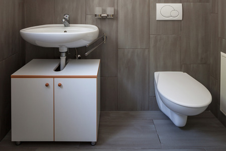 Front view bathroom with sink and toilet. Nobody inside Stok Fotoğraf