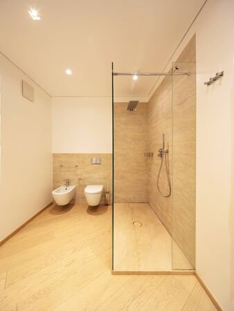 Modern bathroom with wood and marble finishes, elegant bathroom. Nobody inside