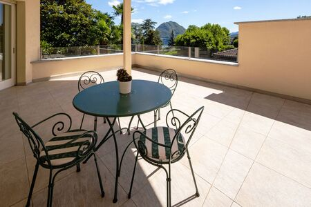 Spacious terrace of modern villa with lake view. Nobody inside Banco de Imagens