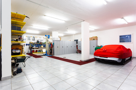 Garage with luxury sports cars. Nobody inside.