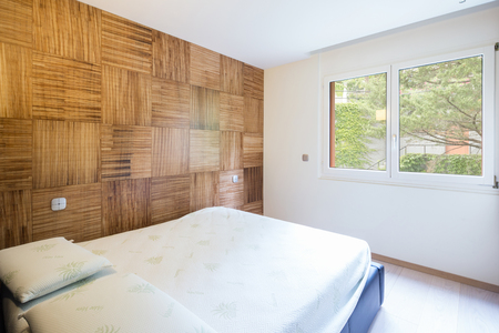Bedroom with parquet in modern apartment. Nobody inside.